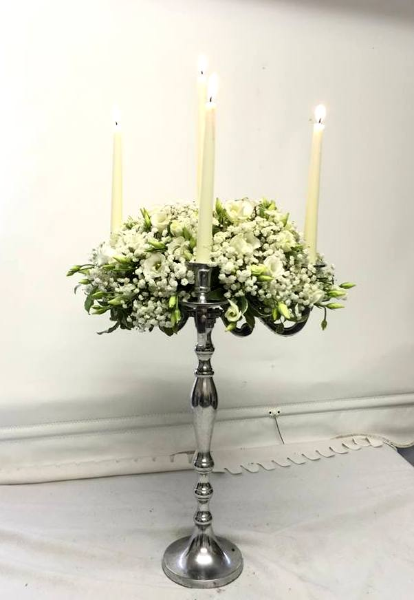 white candelabra arrangement of fresh flowers
