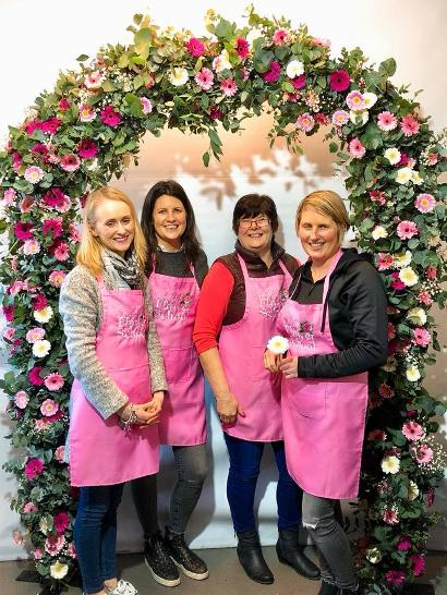 Kenmare Florists make a floral arch