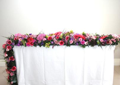 trailing table design in pink flowers at kays schoiol