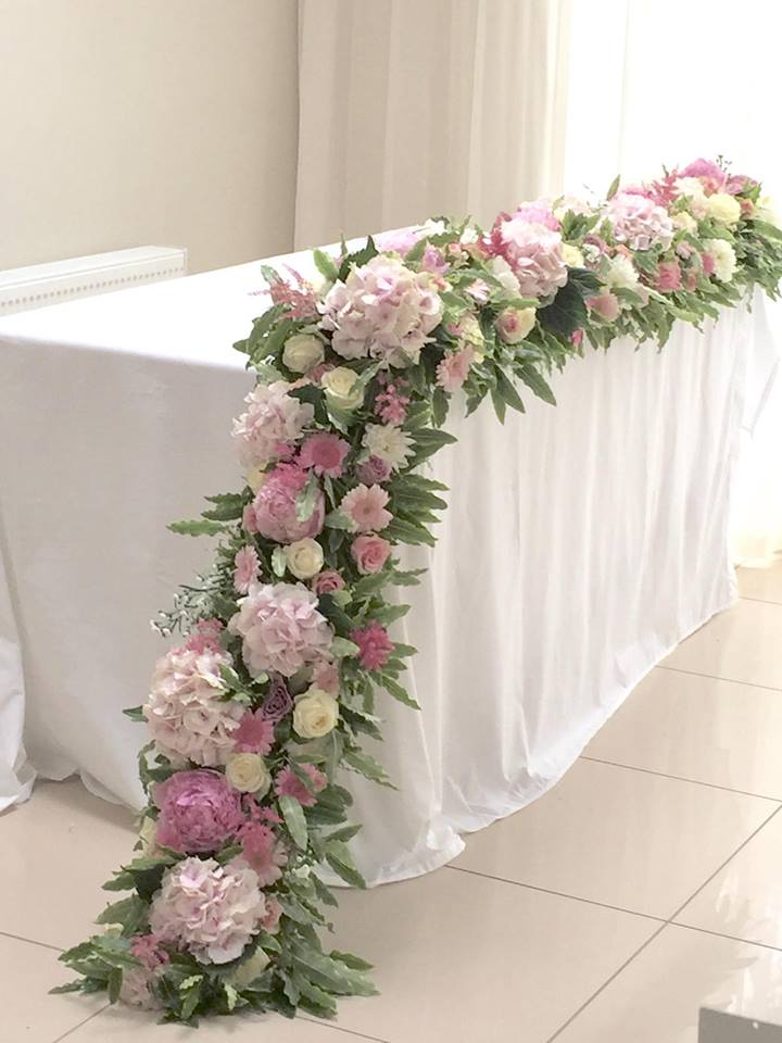 Pale pink floral design at the flower school
