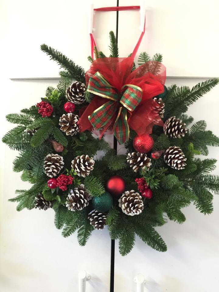 Red Christmas Wreath with white pine cones