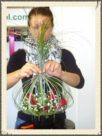 lady with her flower arrangment she made of our flower arranging courses