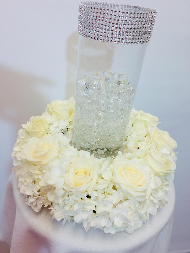 white table glass vase table arrangment
