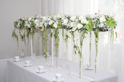 raised white flower wedding table floral design