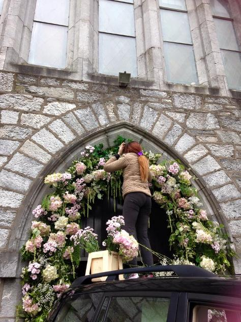 workinf on a wedding Flower Arch